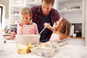 Father baking with children; Shutterstock ID 284484704
